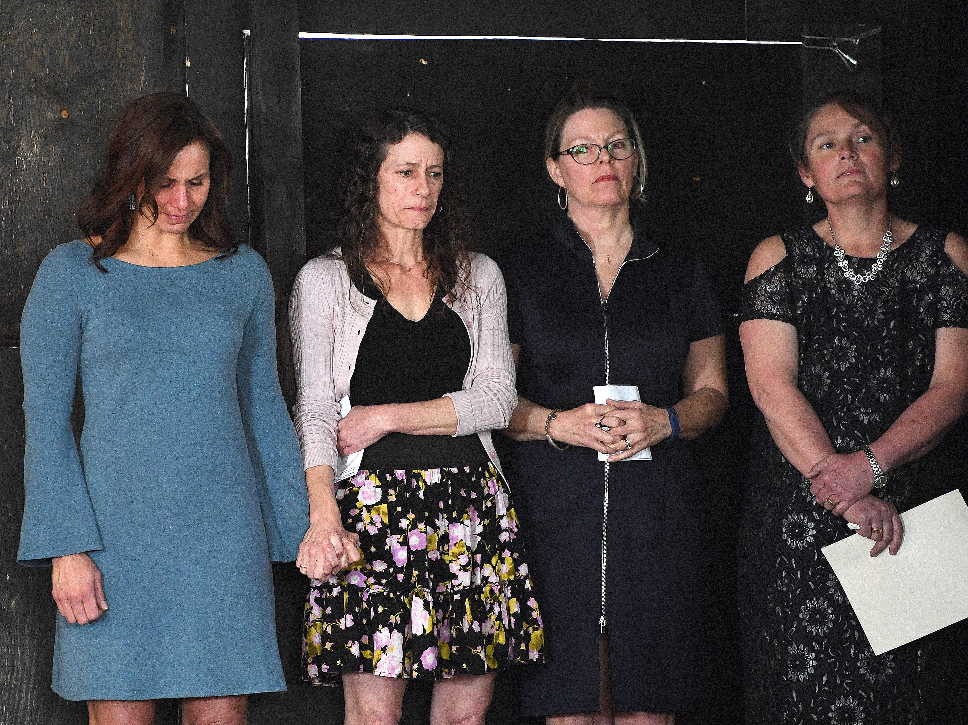 "Close friends of Karen Shuart, Kelley Klope, Anne Squires, Skye Myrick and Joy Ponder comfort each other as they prepare to speak during a memorial service at the Salvage Station on Feb. 15, 2019 for the firefighter who died of cancer last month. Shuart died of cancer, the second cancer-related death in the department in a year. Her death is being considered an ""line-of-duty"" death."
