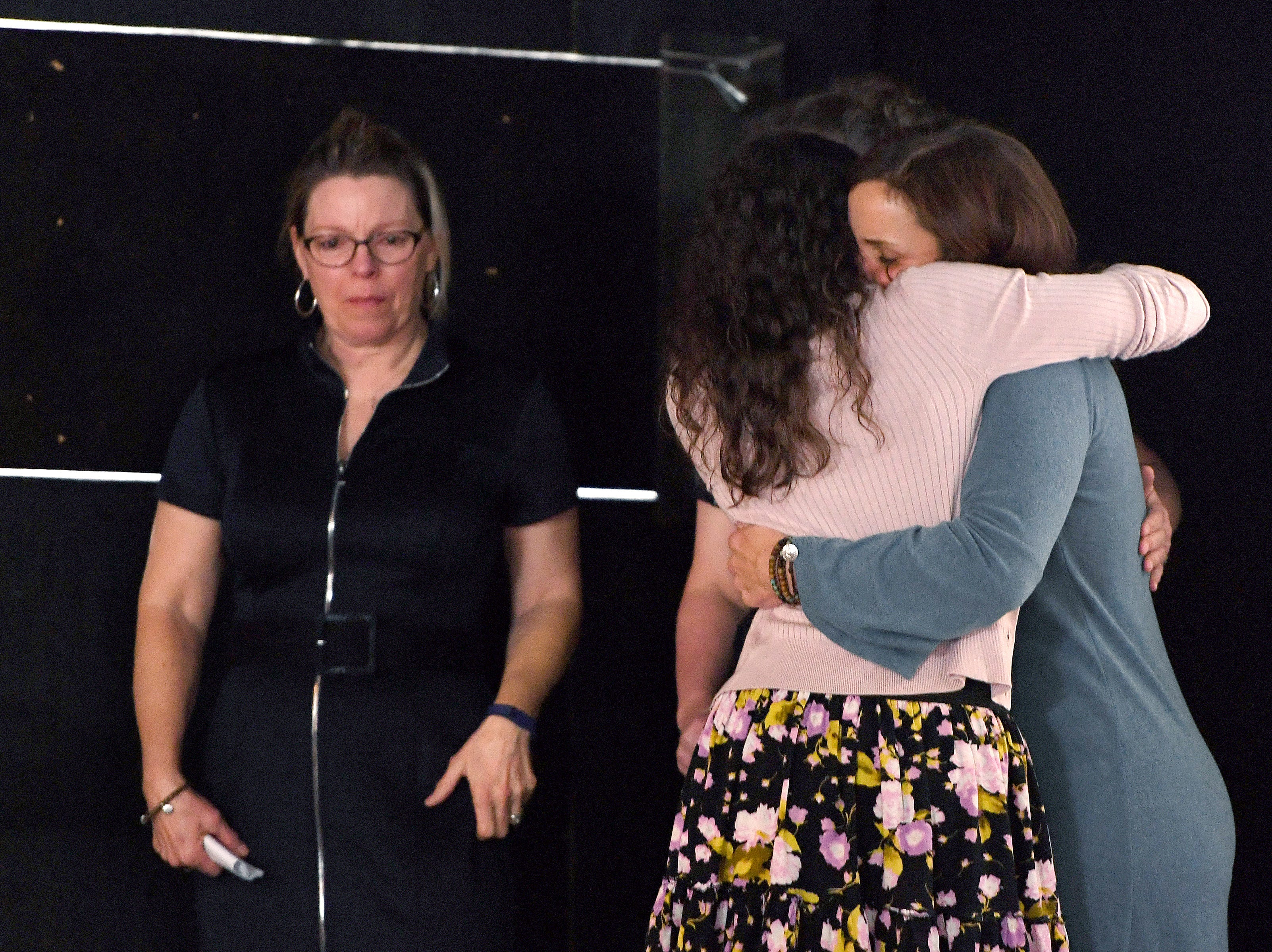 "Close friends of Karen Shuart, Kelley Klope and Anne Squirescomfort each other during a memorial service at the Salvage Station on Feb. 15, 2019 for the firefighter who died of cancer last month. Shuart died of cancer, the second cancer-related death in the department in a year. Her death is being considered an ""line-of-duty"" death."