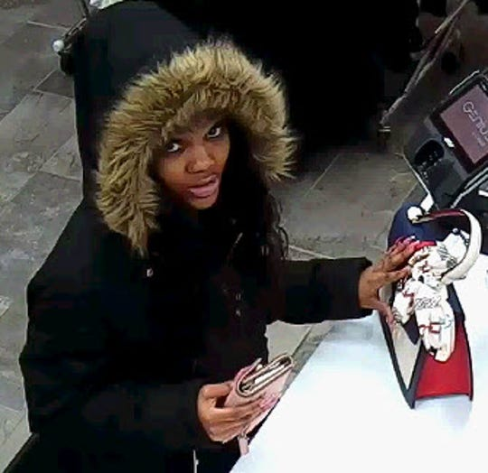 Police said this woman is a suspect in passing counterfeit $100 bills.