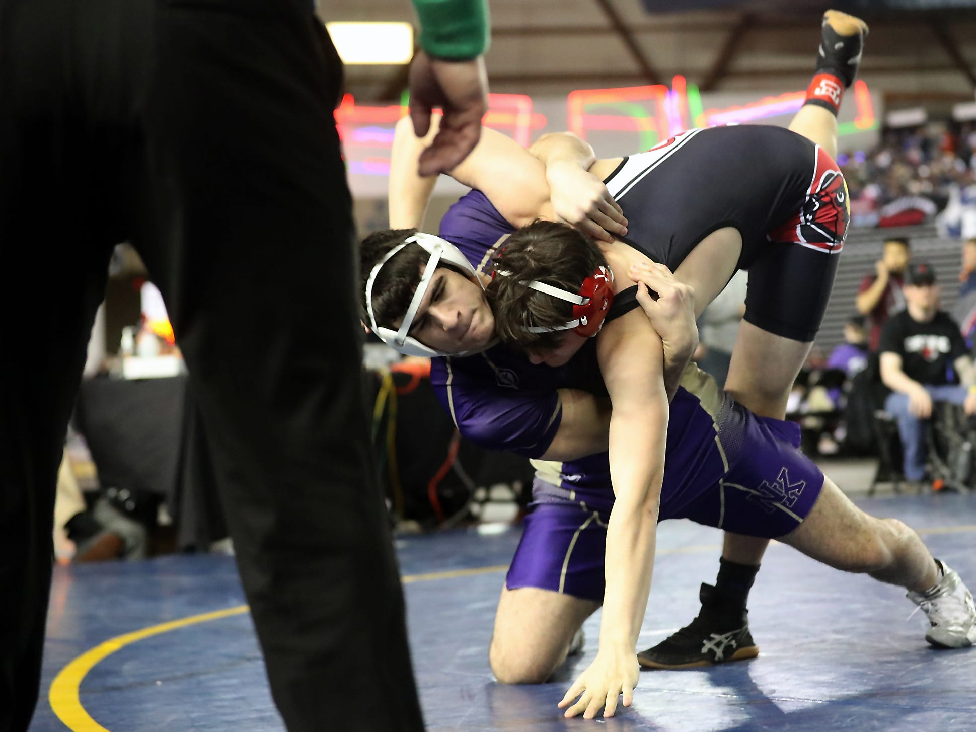 North Kitsap's Nouh Hammou takes down Orting's Daniel Neuman during their 2A 192-pound bout at Mat Classic on Friday, February 15, 2019.