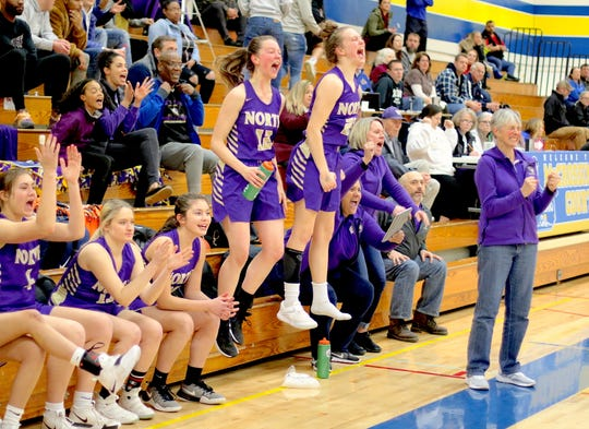 North Kitsap's bench celebrates in the fourth quarter of Thursday's win over Fife in the Class 2A West Central District girls basketball tournament.