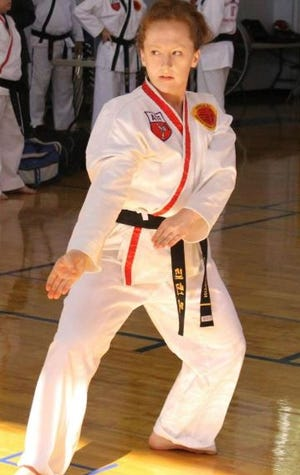 Alana Johnson, owner of Blue Ridge Taekwondo, which is opening a location in Black Mountain this month, participates in a national martial arts tournament.