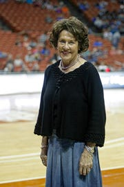 Grandbury Texas High School girl's basketball coach, Leta Andrews, attends the girls' UIL state basketball playoffs as she retires after 52 seasons with a national record 1416 career victories , Friday, Feb. 28, 2014, in Austin, Texas. (AP Photo/Michael Thomas)