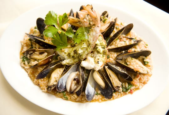 "Risotto ""Frutta di Mare"", (Pesto grilled South African cold water rock lobster, jumbo lump crabmeat, and Prince Edward Island mussels simmered in a sun-dried tomato spinach risotto) prepared by Chef Robert Minniti at his former Bacio Restaurant in Cinnaminson."