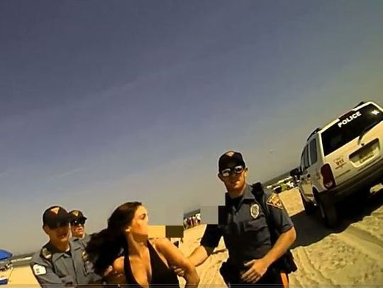 Wildwood police escort Emily Weinman from the beach in May 2018.