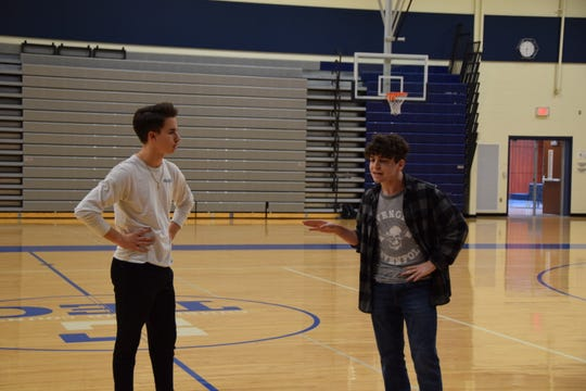 Ren McCormack (Dom Vargo) and Willard Hewitt (Caleb Jones) talk in the gym during a scene in Cumberland County Technical Education Center's 'Footloose.'