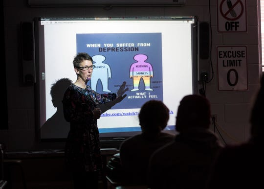 Zane Trace health teacher Kim Lashley goes over some of the signs of depression with Zane Trace seniors after the students watched a short video concerning mental health.