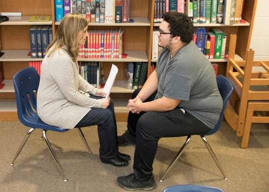 Kathy Wolfe, left, discusses the Signs of Suicide program with Christian King Thursday afternoon at Zane Trace High School. The one-on-one discussion is part of Zane Trace's initiative to talk to students about their mental health and see if further assistance is needed.