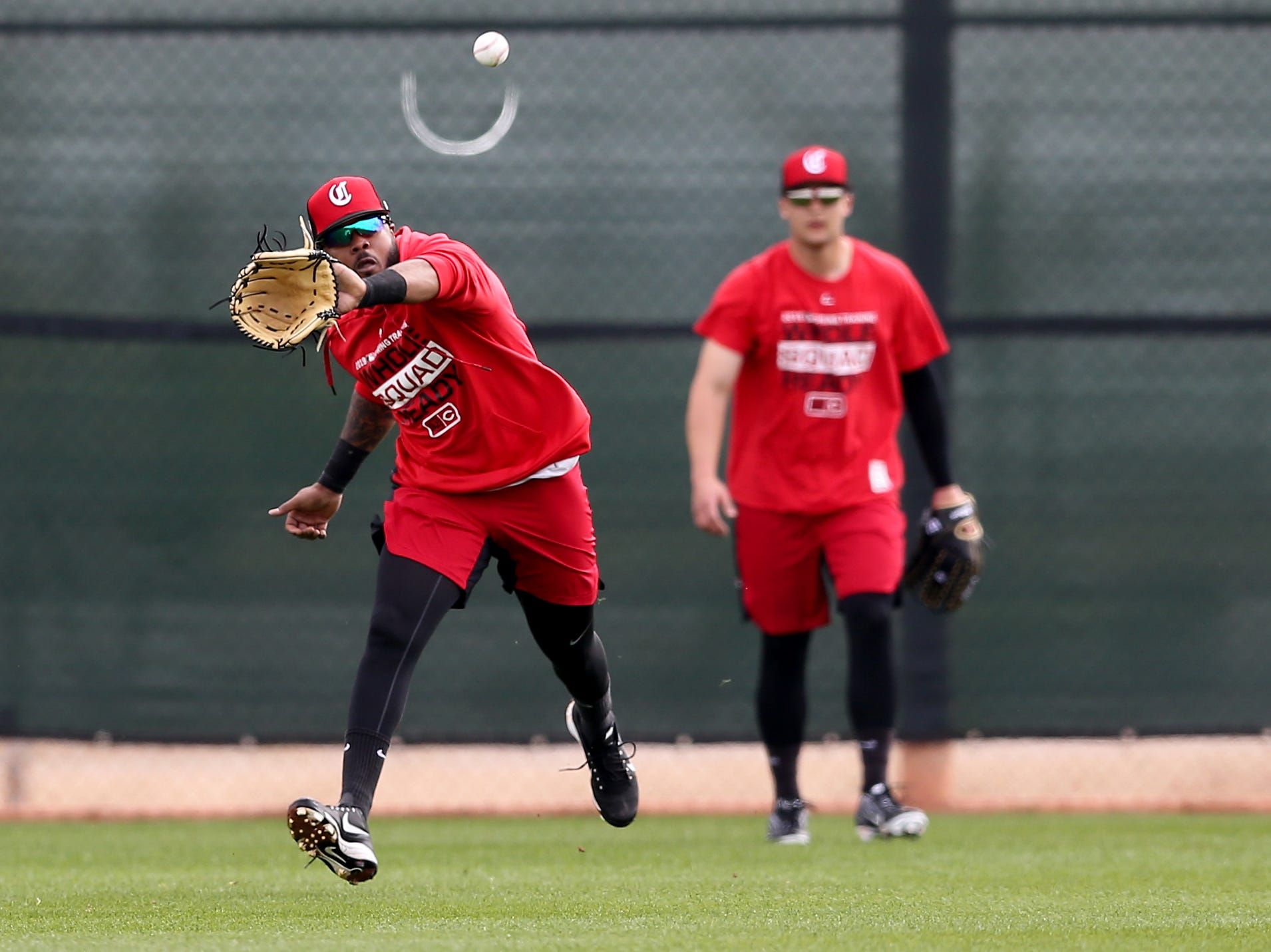 Cincinnati Reds outfielder Phillip Ervin (6) fields a fly ball, Friday, Feb. 15, 2019, at the Cincinnati Reds spring training facility in Goodyear, Arizona.