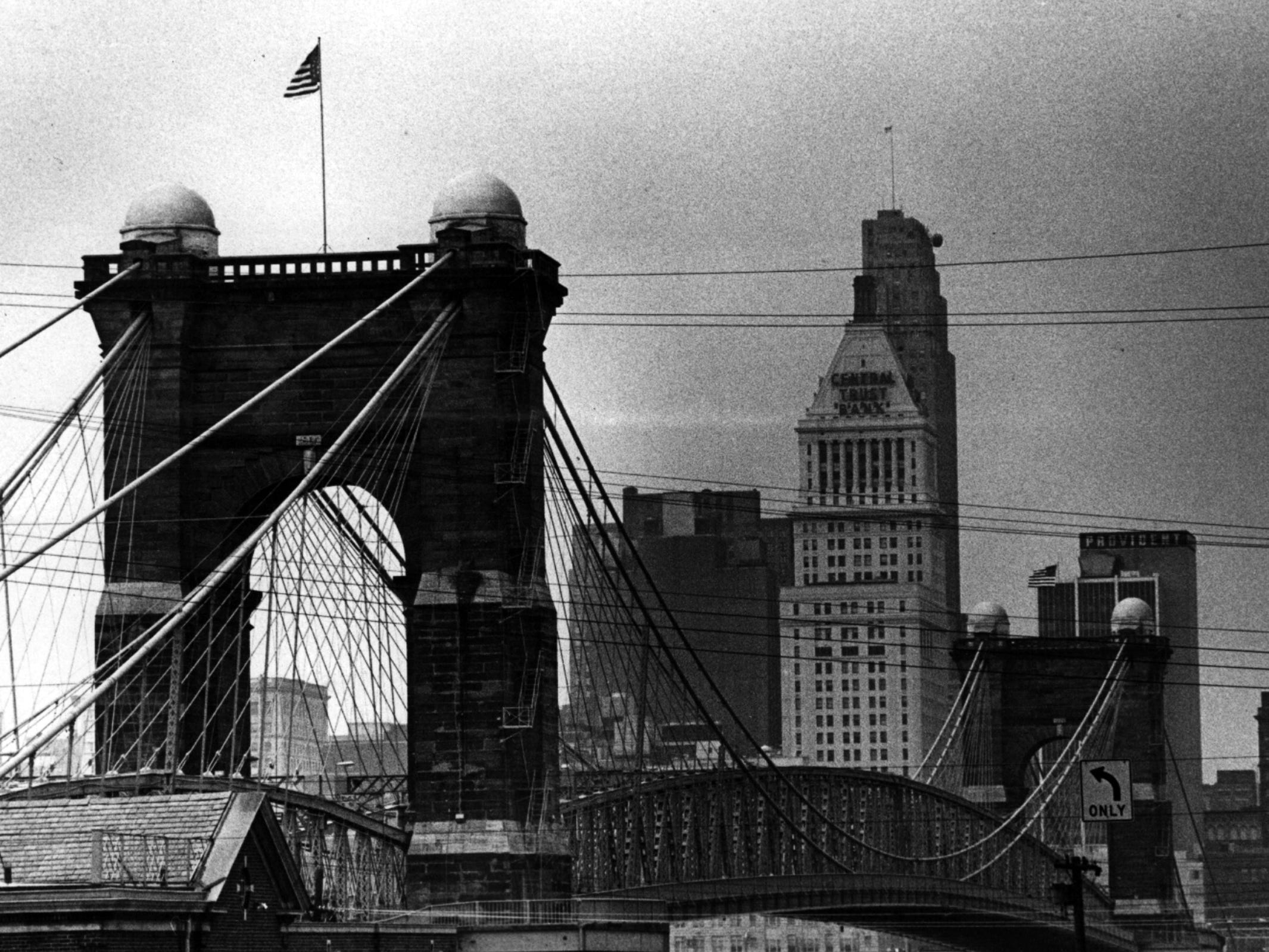 DECEMBER 19, 1977: Stars and stripes and the Bennington flag again fly over the Suspension Bridge after a series of snatchings and the conviction of an Erlanger man for taking the bridge's flags. From the Enquirer archives scanned May 16, 2013