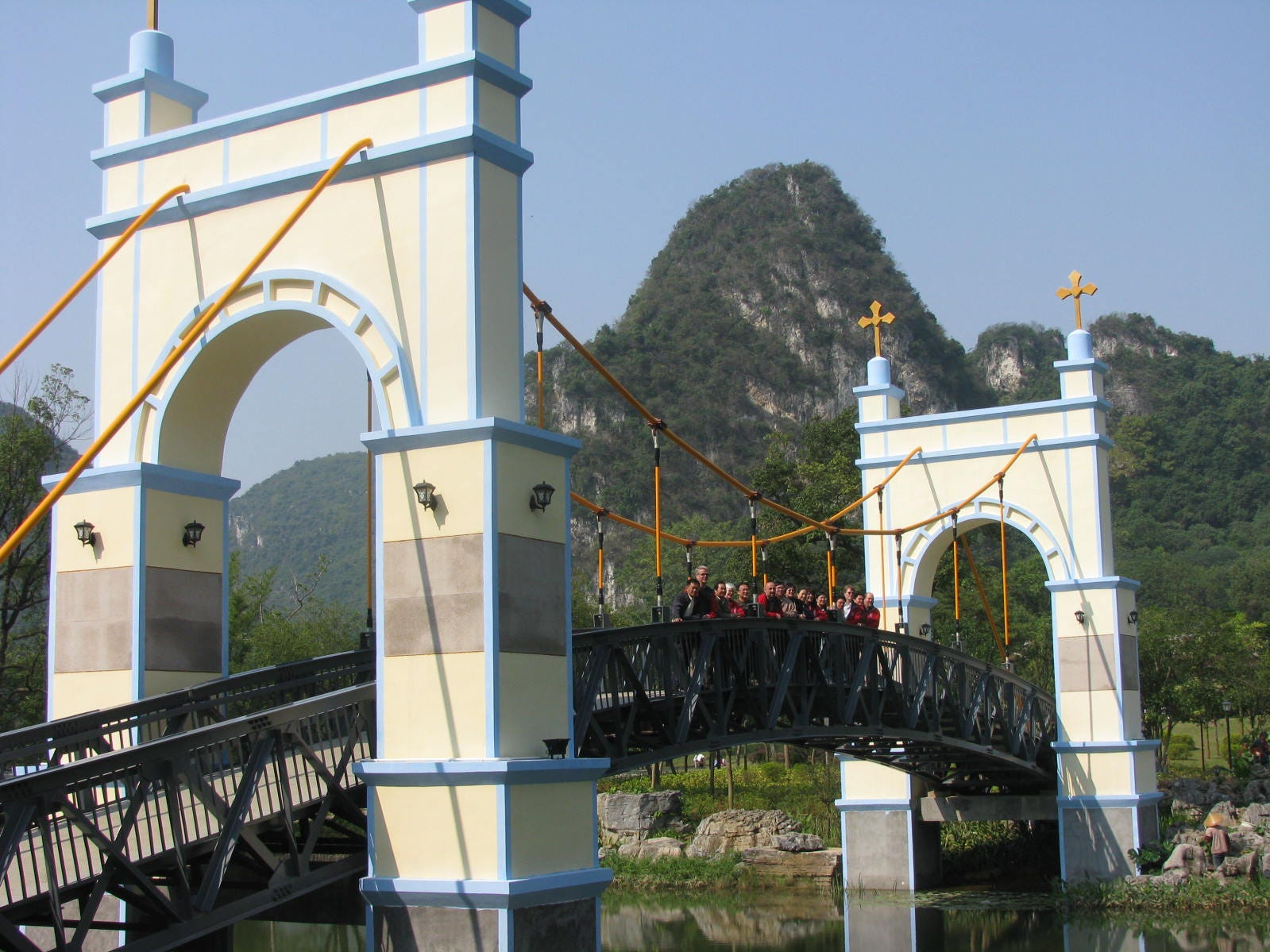 A delegation of visitors from Cincinnati stands on a replica of the Roebling Suspension Bridge in Liuzhou, China, during a visit to Cincinnati's sister city in autumn 2008.