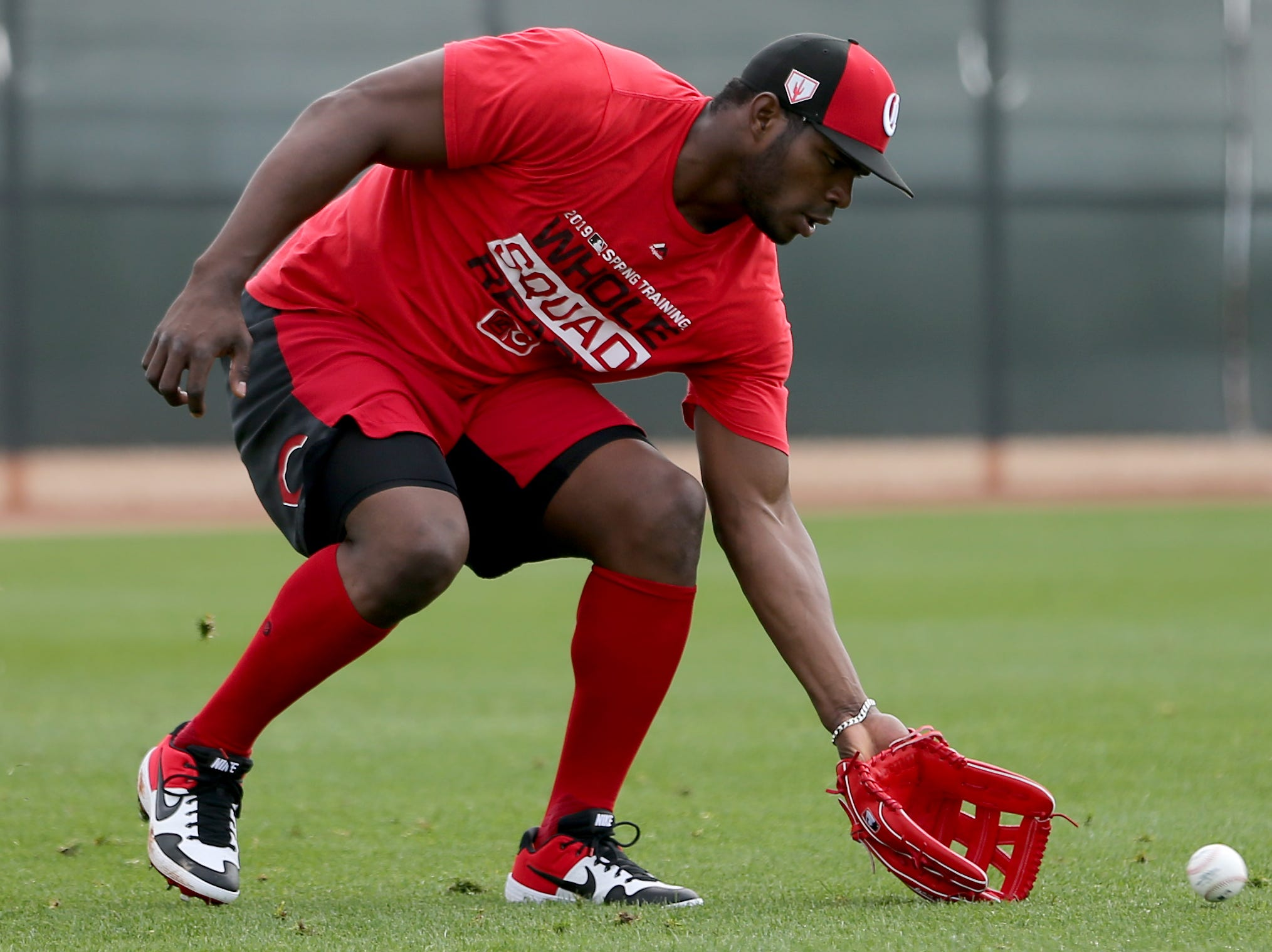 Cincinnati Reds right fielder Yasiel Puig (66) fields a ball, Friday, Feb. 15, 2019, at the Cincinnati Reds spring training facility in Goodyear, Arizona.
