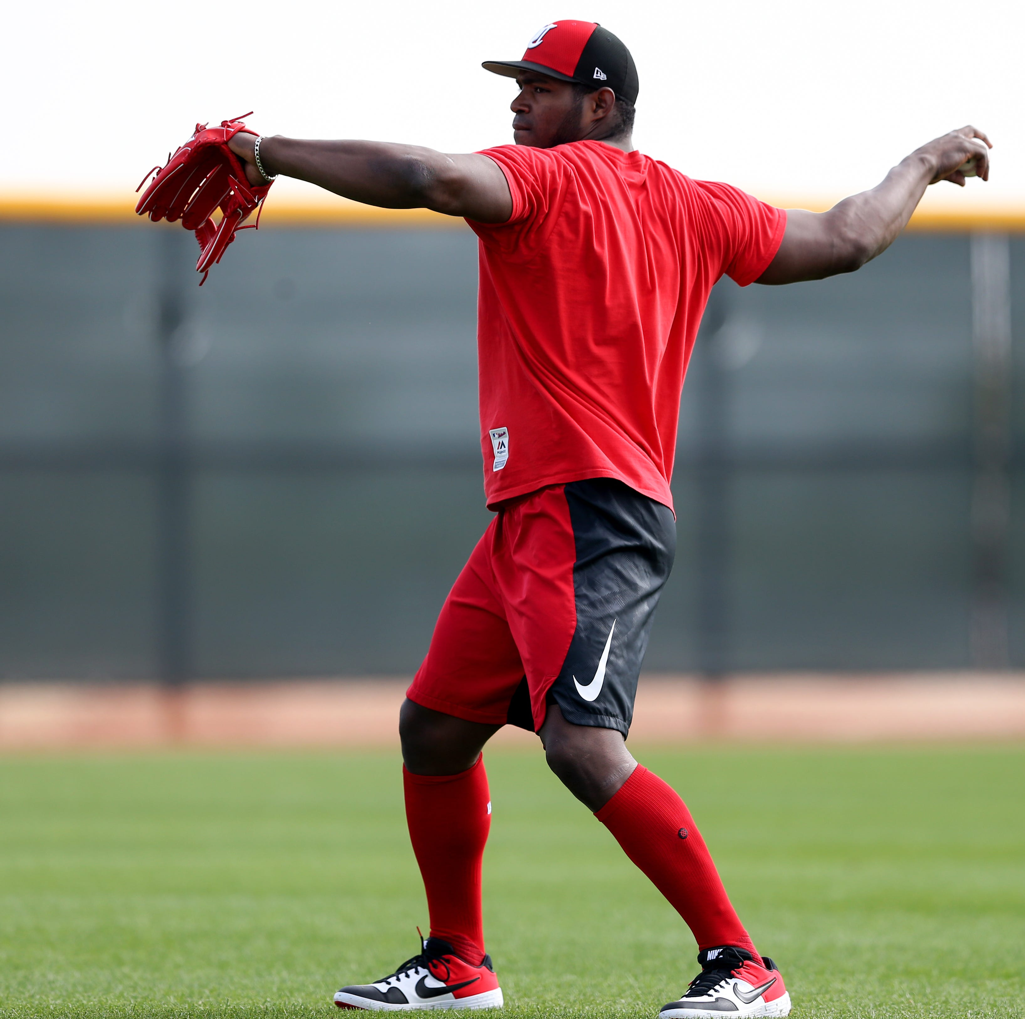 Juggling outfielders' playing time will be Reds manager David Bell's toughest early test