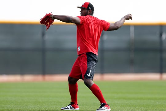 Cincinnati Reds right fielder Yasiel Puig (66) long tosses, Friday, Feb. 15, 2019, at the Cincinnati Reds spring training facility in Goodyear, Arizona.