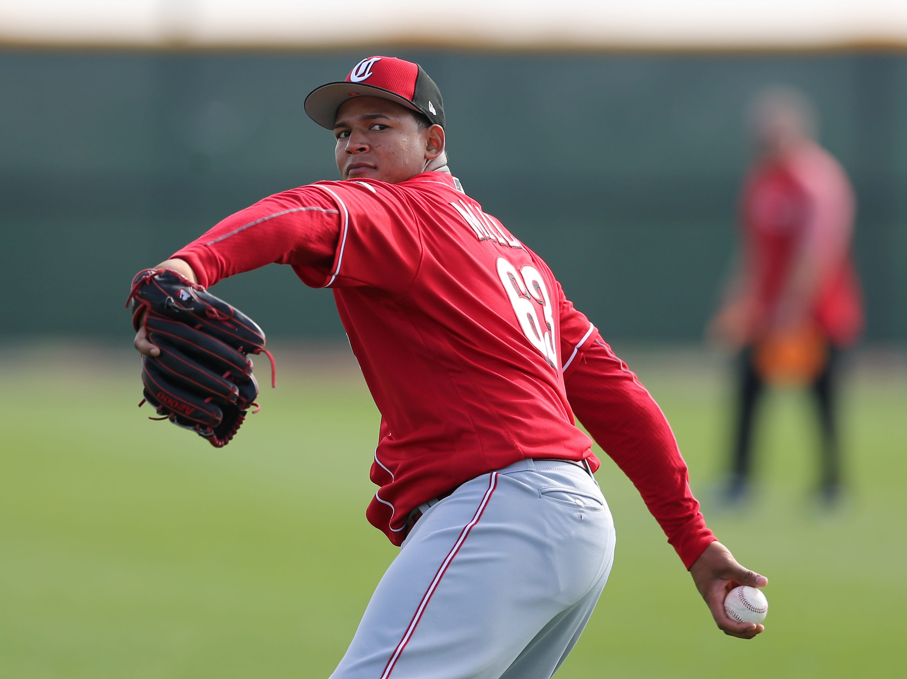 Cincinnati Reds pitcher Keury Mella (63) long tosses, Friday, Feb. 15, 2019, at the Cincinnati Reds spring training facility in Goodyear, Arizona.