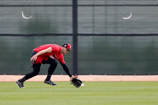 Cincinnati Reds infielder/outfielder Nick Senzel (15) fields a ball in the outfield, Friday, Feb. 15, 2019, at the Cincinnati Reds spring training facility in Goodyear, Arizona.