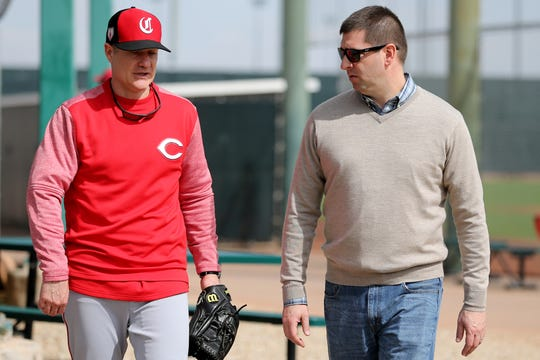 Cincinnati Reds manager David Bell (25), left, talks with general manager Nick Krall, right, Cincinnati Reds pitchers and catchers work out, Friday, Feb. 15, 2019, at the Cincinnati Reds spring training facility in Goodyear, Arizona.