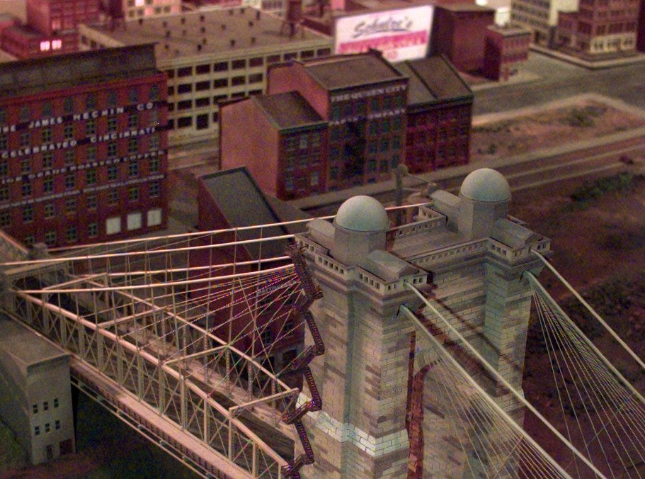 Text: 1999.1117.02.1-- DIGITAL IMAGE -- MODELCITY -- View of the Roebling suspension bridge on the riverfront. The scene is part of Cincinnati in Motion, a new exhibit being built at the Museum Center at Union Terminal. The scale model depicts Cincinnati in the 1940's. Cincinnati Enquirer photo by Gary Landers. gl