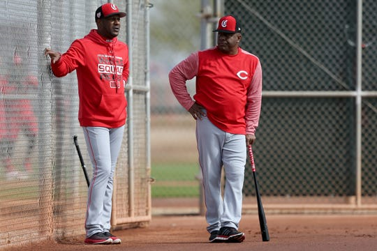 Former Cincinnati Reds players and spring training special assistants Eric Davis, left, and Billy Hatcher, right, observe position players work out, Friday, Feb. 15, 2019, at the Cincinnati Reds spring training facility in Goodyear, Arizona.
