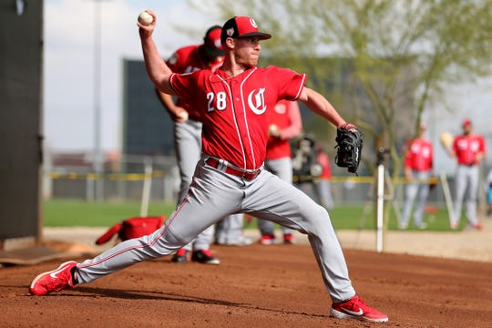 Cincinnati Reds starting pitcher Anthony DeSclafani (28) delivers during a bullpen session, Friday, Feb. 15, 2019, at the Cincinnati Reds spring training facility in Goodyear, Arizona.