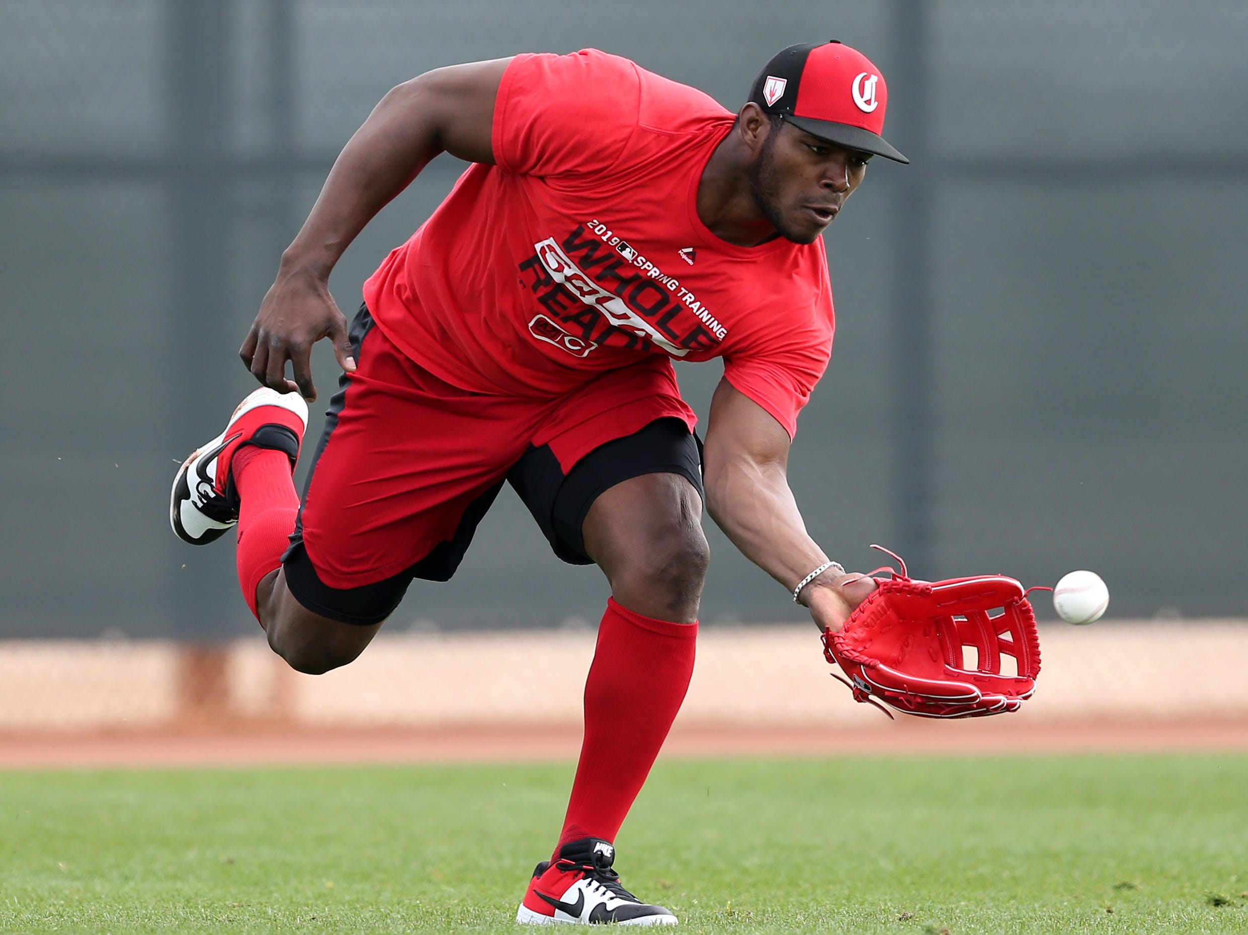 Cincinnati Reds right fielder Yasiel Puig (66) fields a fly ball, Friday, Feb. 15, 2019, at the Cincinnati Reds spring training facility in Goodyear, Arizona.