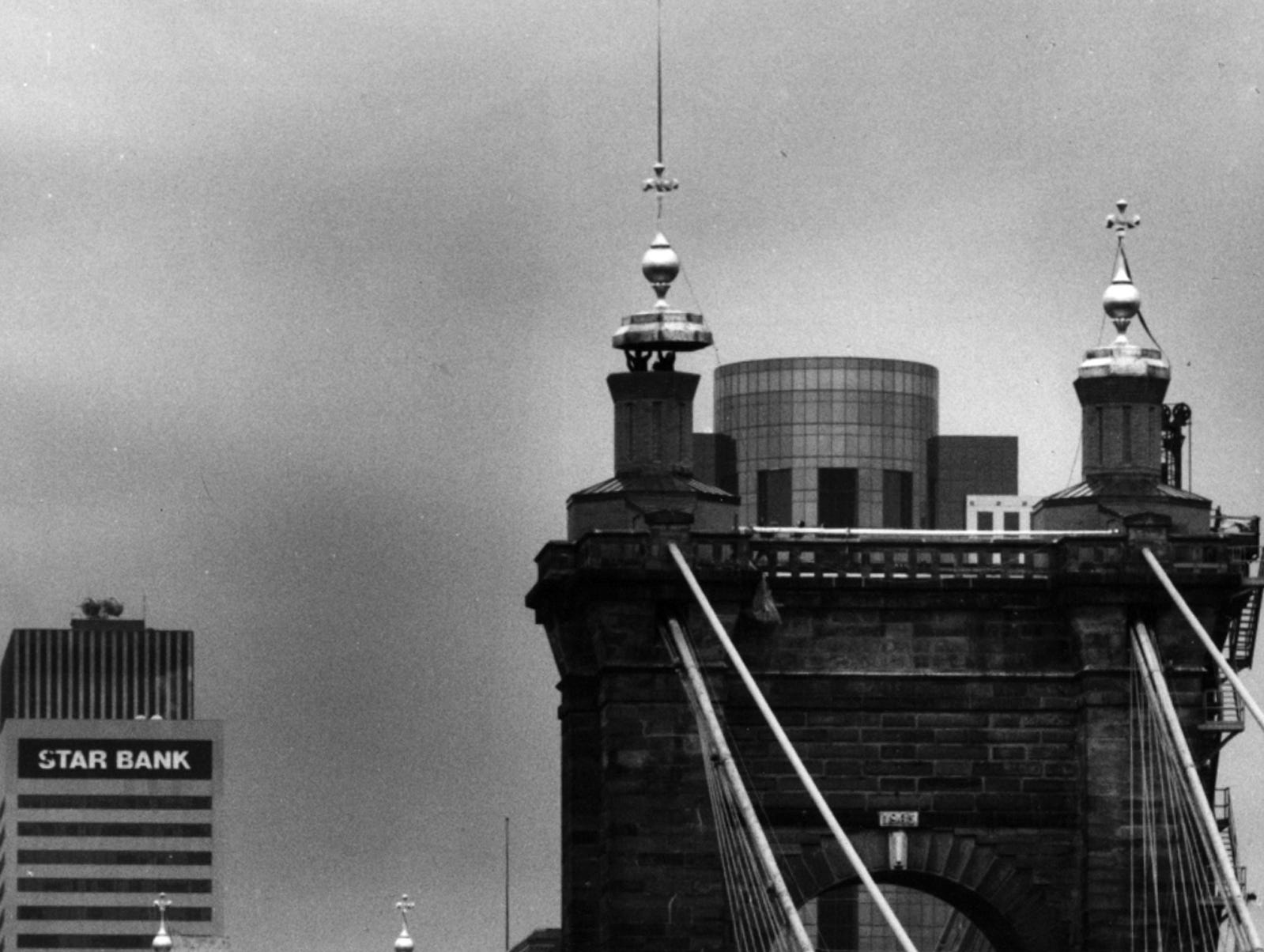 MARCH 7, 1992: The last of four turrets is lowered onto a tower atop the John A. Roebling Suspension Bridge Saturday morning. Photo shot looking north from the Kentucky side of the Ohio River. The Enquirer/Gary Landers scanned May 16, 2013