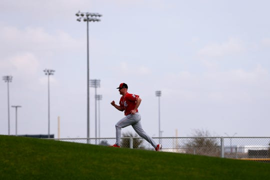 Cincinnati Reds starting pitcher Anthony DeSclafani (28) runs up a conditioning hill, Friday, Feb. 15, 2019, at the Cincinnati Reds spring training facility in Goodyear, Arizona.