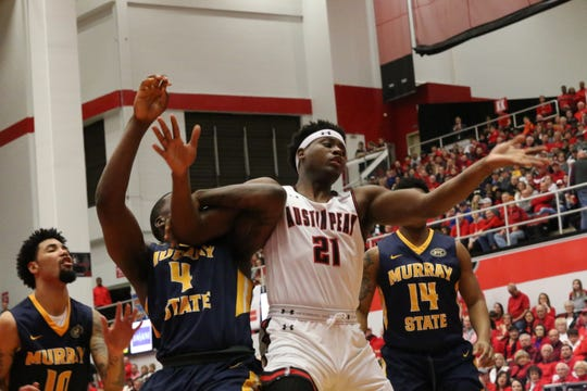 Austin Peay's Terry Taylor (21) tries to fend off a Murray State player during the first half of their OVC game Thursday.