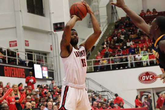 Austin Peay's Jabari McGhee looks for a teammate in the post against Murray State in the first half of their OVC game Thursday at the Dunn Center.