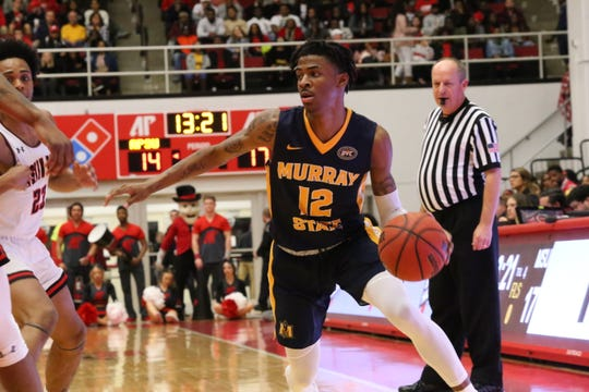 Murray State's Ja Morant tries to drive around Austin Peay's defense during the first half of their OVC game Thursday.