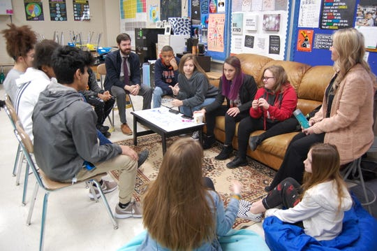 Students at Northeast Middle School participate in a proactive circle with their principal Laura Boss and assistant principal Evan Stinson.