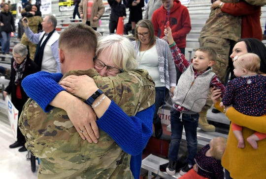 """Susan Erickson hugs her son, Ben, during a welcome home ceremony form  171 soldiers assigned to """"Task Force Destiny,"""" 101st Combat Aviation Brigade, 101st Airborne Division (Air Assault) returned to Fort Campbell, KY on Friday, Feb. 15, 2019 after a nine-month deployment to Afghanistan."""