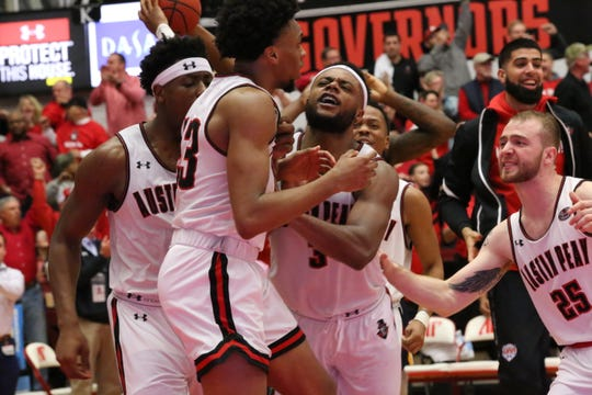 Austin Peay players celebrate what they thought was the game-tying field goal from Steve Harris as time expired in regulation against Murray State Thursday night. But officials ruled the shot off as the Racers won 73-71.