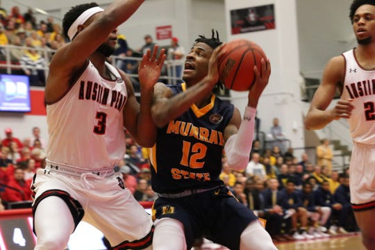 Murray State's Ja Morant (12) goes up for a shot under the basket against Austin Peay's Chris Porter-Bunton (3) during their OVC game Thursday night at the Dunn Center.