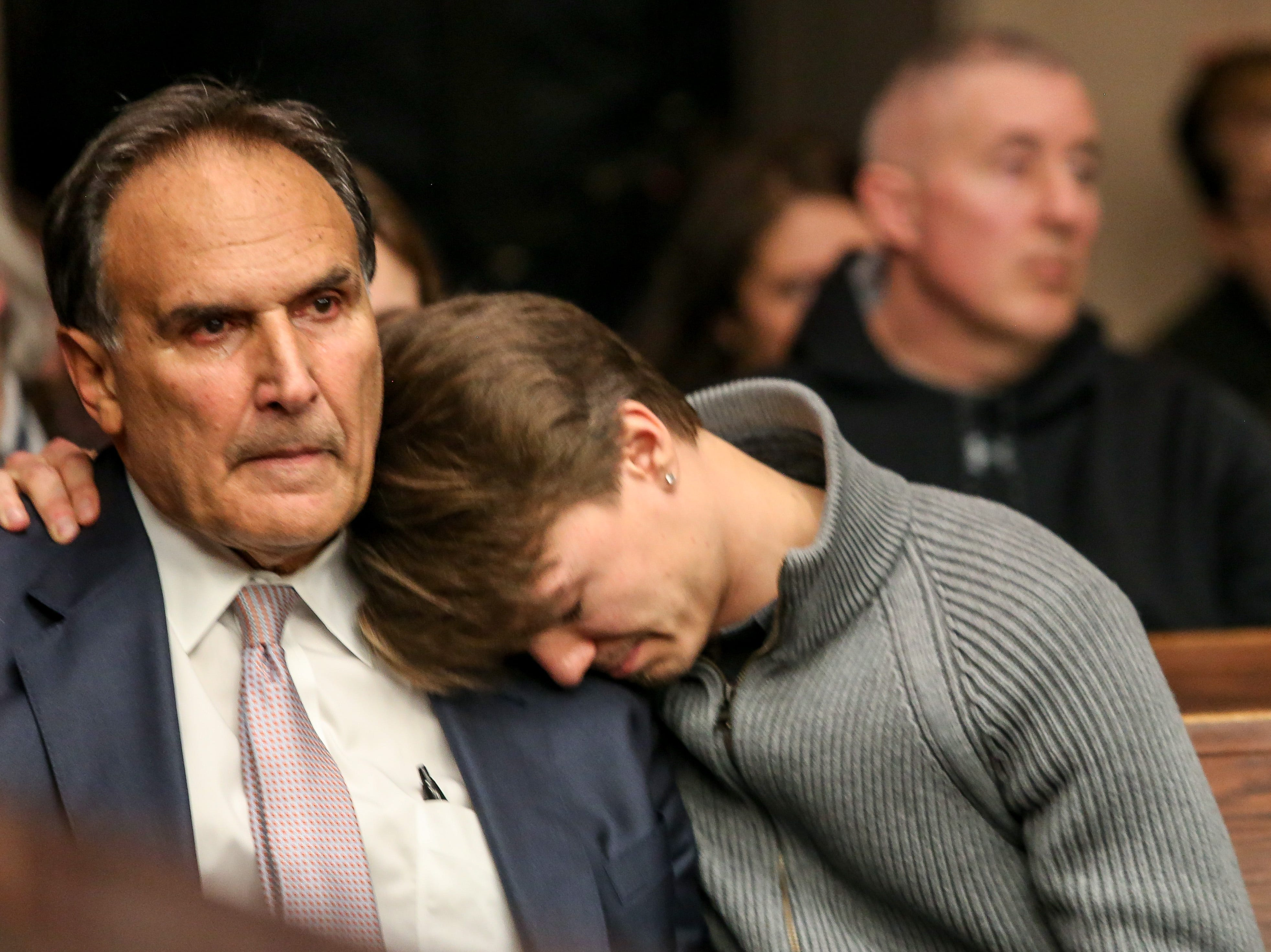 Victim's family member's Fred Seeman is hugged by his son Ford Seeman during Amy Locane's resentencing for a fatal 2010 auto accident inside Judge Kevin Shanahan's courtroom at the Somerset County Superior Courthouse in Somerville on February 15, 2019. Alexandra Pais/ for the Courier News