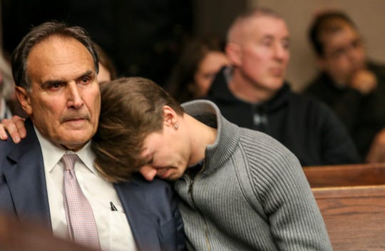 Helene Seeman's husband Fred Seeman, left, is hugged by their son, Ford Seeman, during Amy Locane's resentencing for the fatal 2010 Montgomery auto accident inside Judge Kevin Shanahan's courtroom at the Somerset County Superior Courthouse in Somerville on Feb. 15, 2019.