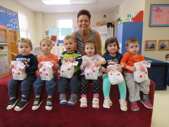 Waddler Class Prepares Breakfast to Go Bags for all the parents at the school with their teacher Jackie Russano Weiss.