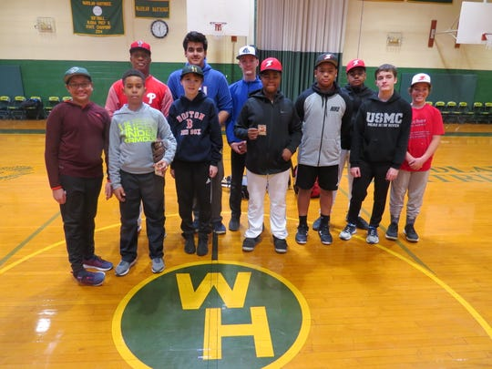 Shiv Tickoo of Scotch Plains takes batting tips from Milt Thompson during a recent baseball clinic at Wardlaw+Hartridge.
