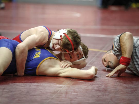 West Sioux-Hawarden junior Adam Allard pins Martensdale-St. Mary's sophomore Cael Cassady in their match at 120 pounds during the state wrestling quarterfinals on Friday, Feb. 15, 2019, at Wells Fargo Arena in Des Moines.