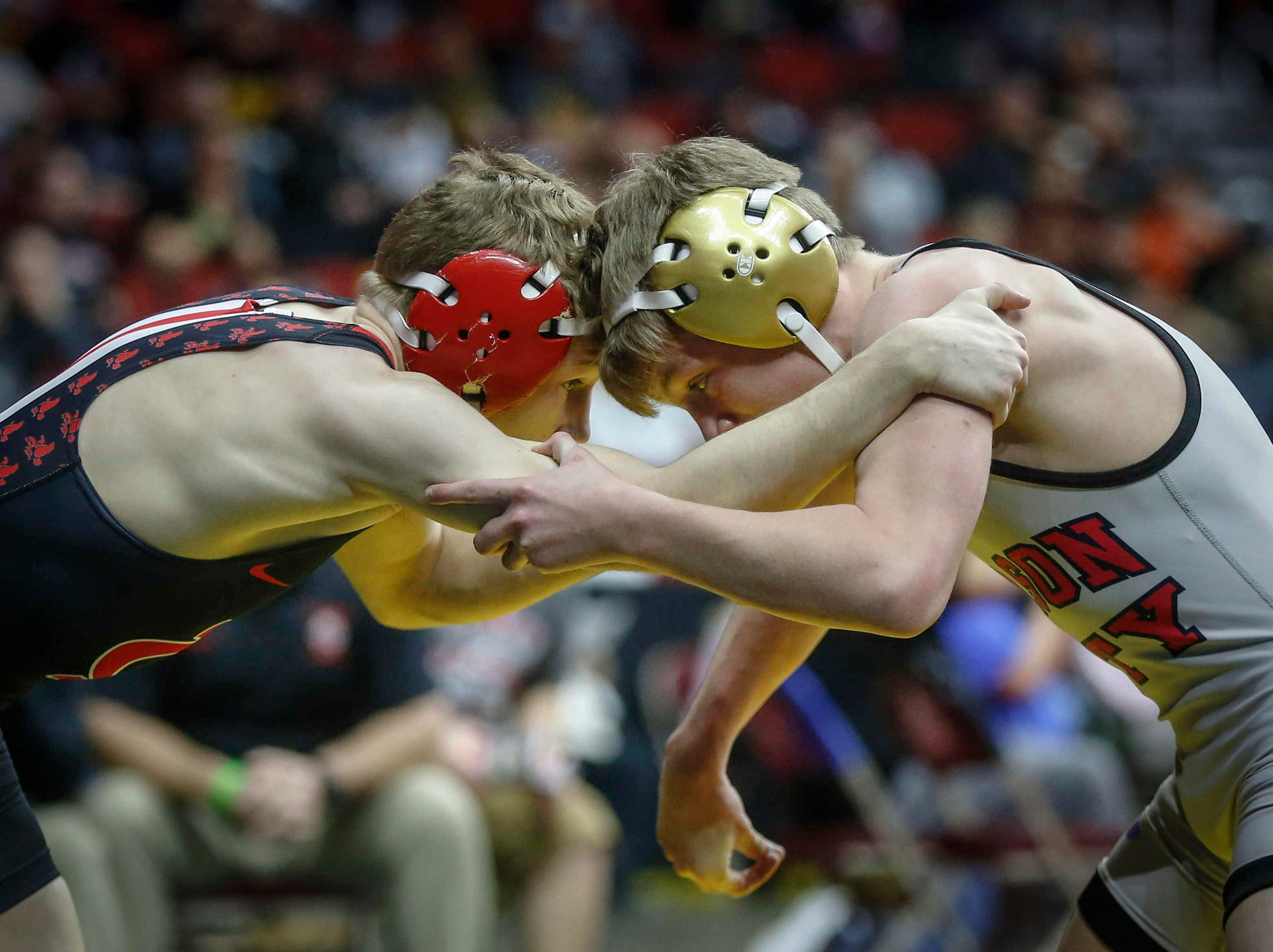 Iowa City High's Ethan Wood-Finley, left, locks up with Mason City's Jace Rhodes in their match at 106 pounds during the state wrestling quarterfinals on Friday, Feb. 15, 2019, at Wells Fargo Arena in Des Moines.