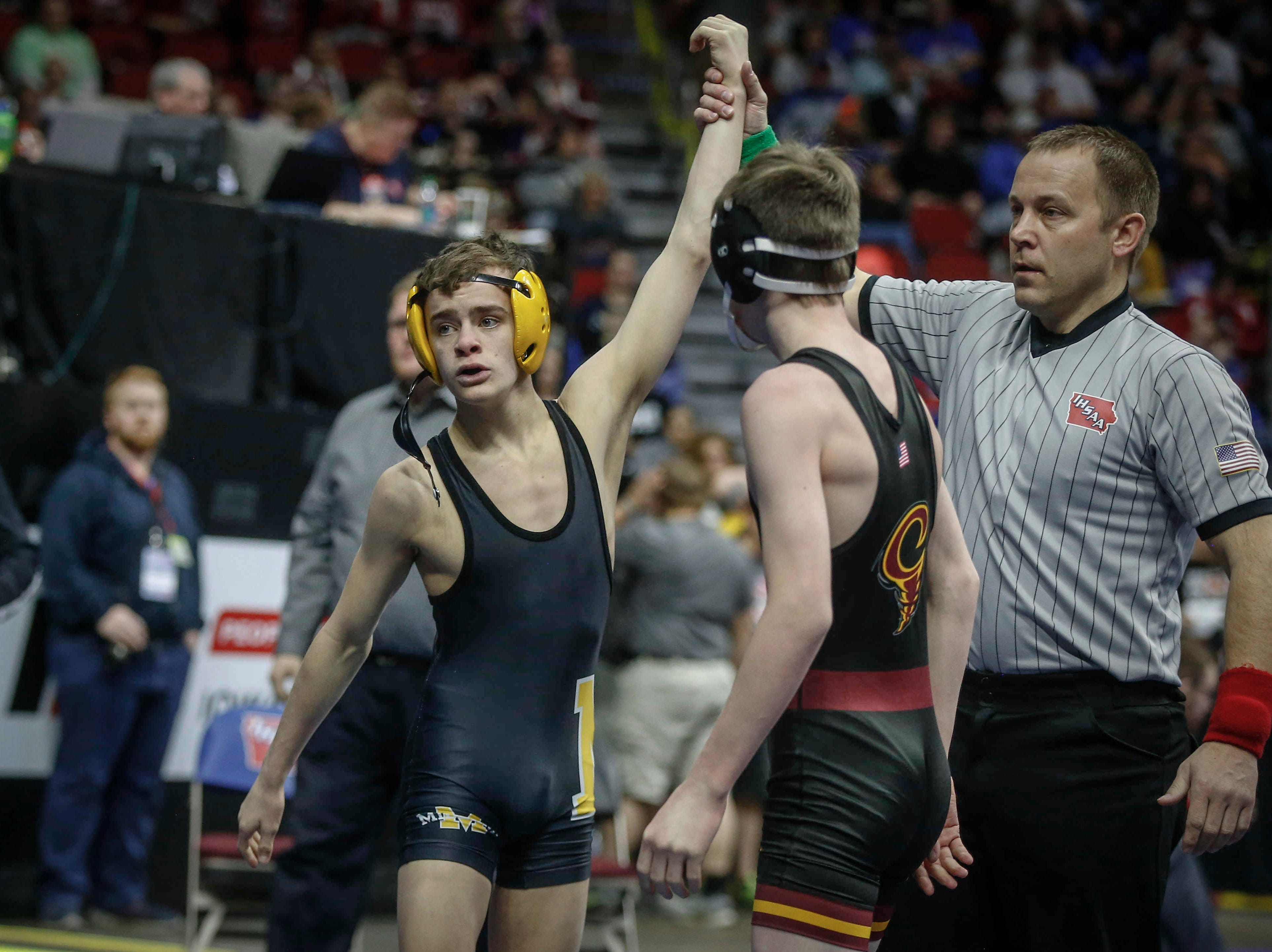 Midland sophomore Damon Huston beat Denver freshman Joe Ebaugh in their match at 106 pounds during the state wrestling quarterfinals on Friday, Feb. 15, 2019, at Wells Fargo Arena in Des Moines.