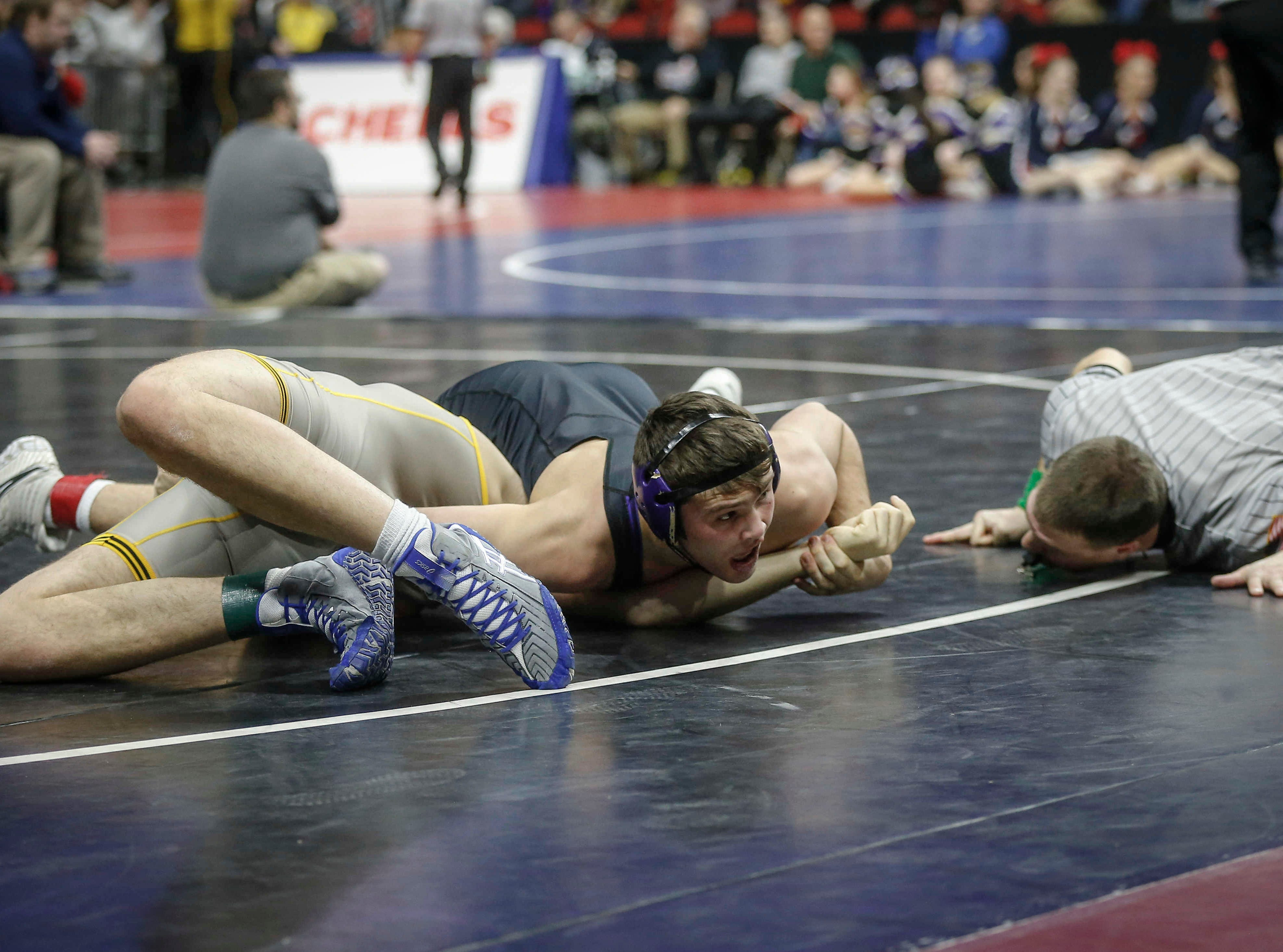 Waukee senior Anthony Zach pins Waverly-Shell Rock junior Gavin Wedemeier in their match at 170 pounds during the state wrestling quarterfinals on Friday, Feb. 15, 2019, at Wells Fargo Arena in Des Moines.
