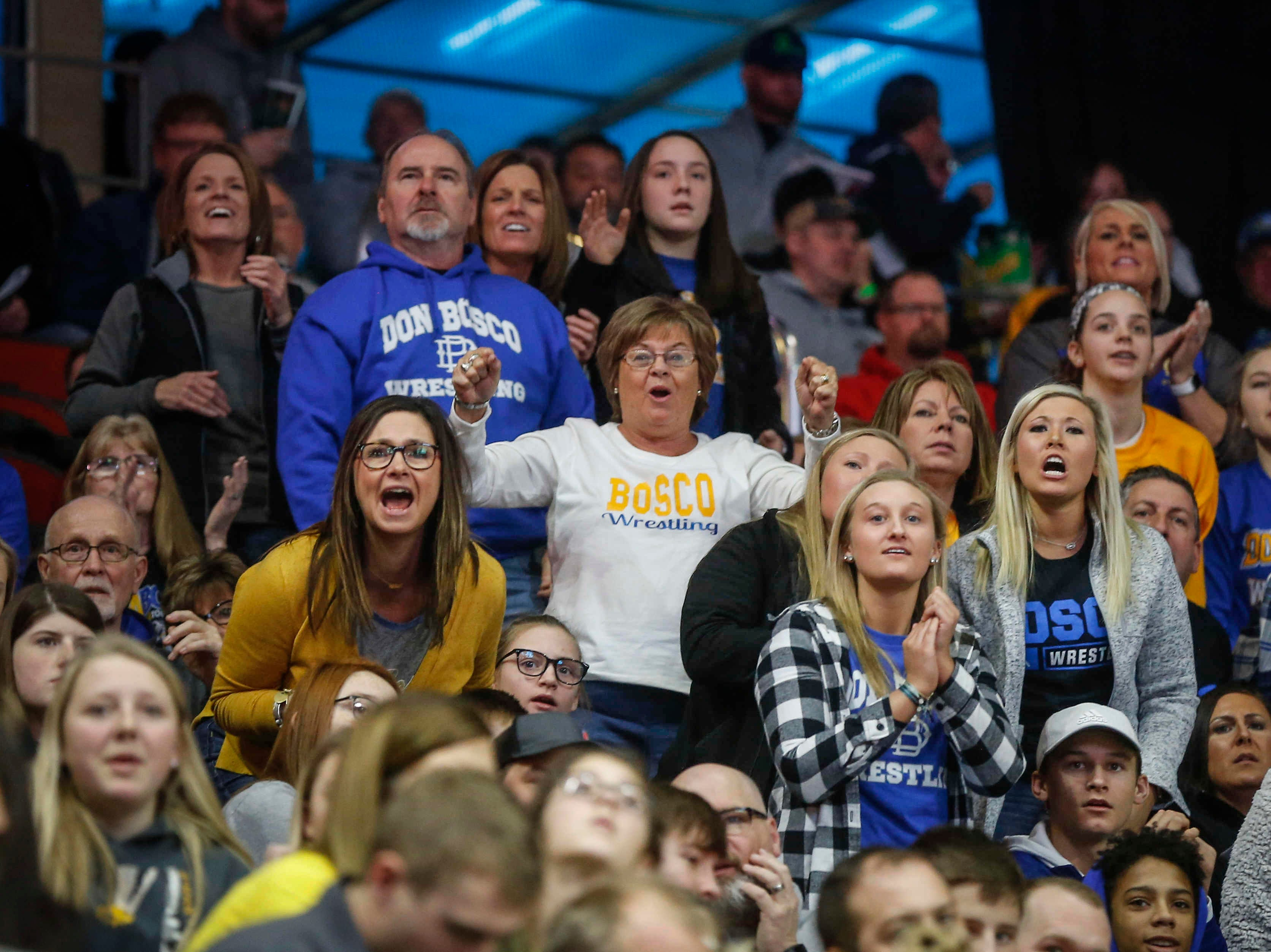 Don Bosco fans cheer during the state wrestling quarterfinals on Friday, Feb. 15, 2019, at Wells Fargo Arena in Des Moines.
