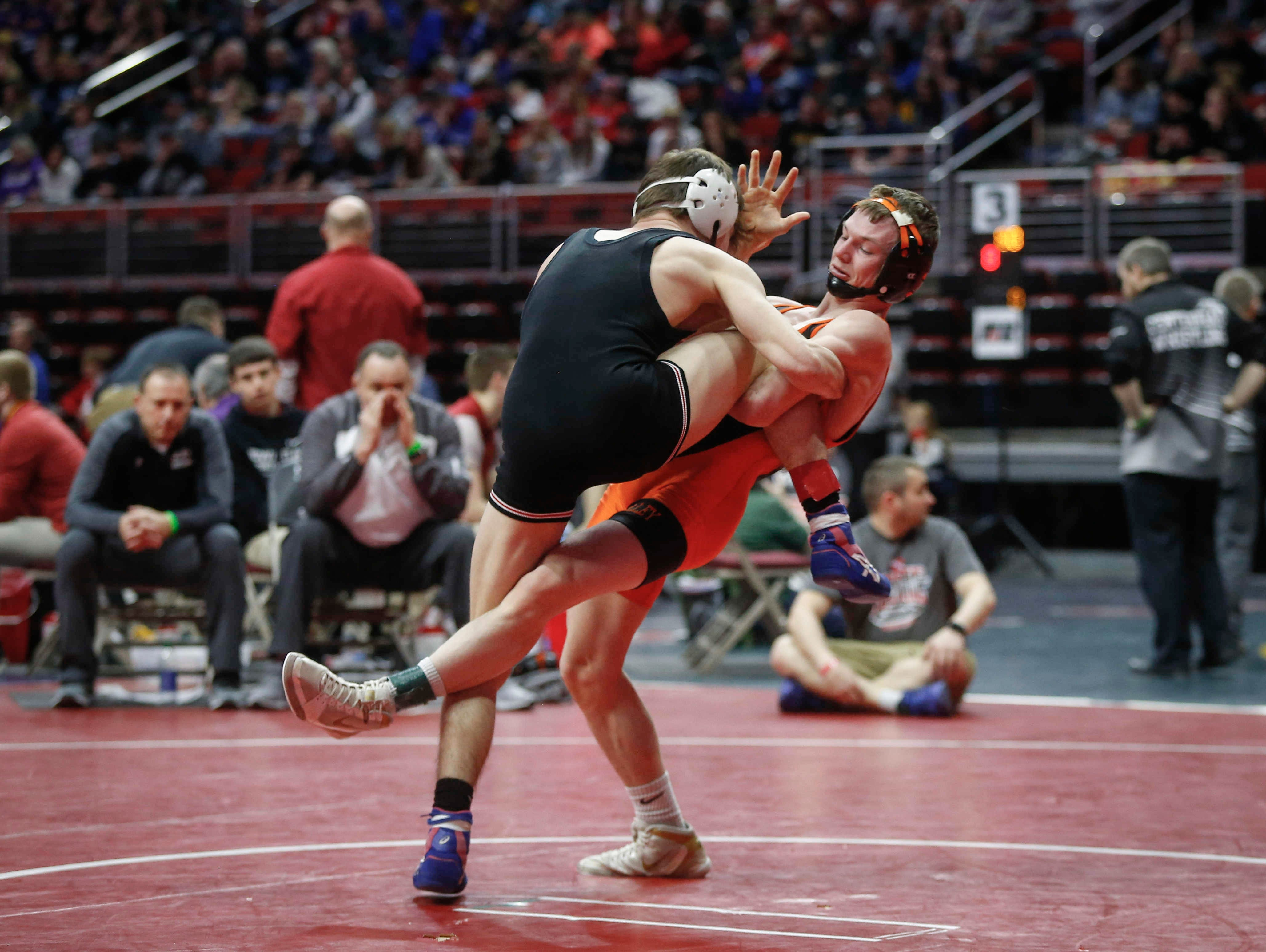 West Des Moines Valley's Nick Oldham trips up Fort Dodge's Brooks Cowell in their match at 126 pounds during the state wrestling quarterfinals on Friday, Feb. 15, 2019, at Wells Fargo Arena in Des Moines.