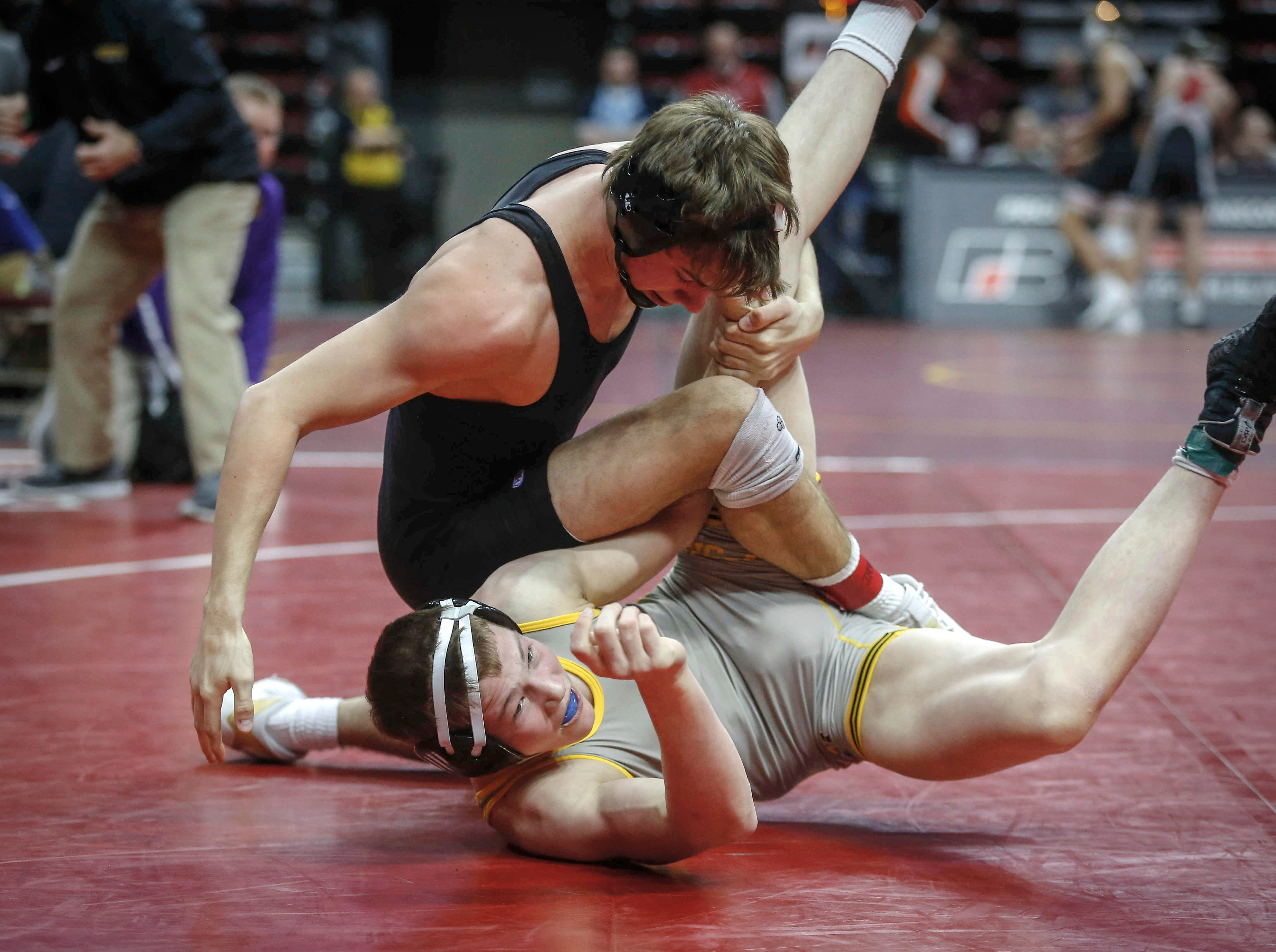 Johnston senior Cade Moss breaks down Waverly-Shell Rock senior Bryson Hervol in their match at 152 pounds during the state wrestling quarterfinals on Friday, Feb. 15, 2019, at Wells Fargo Arena in Des Moines.