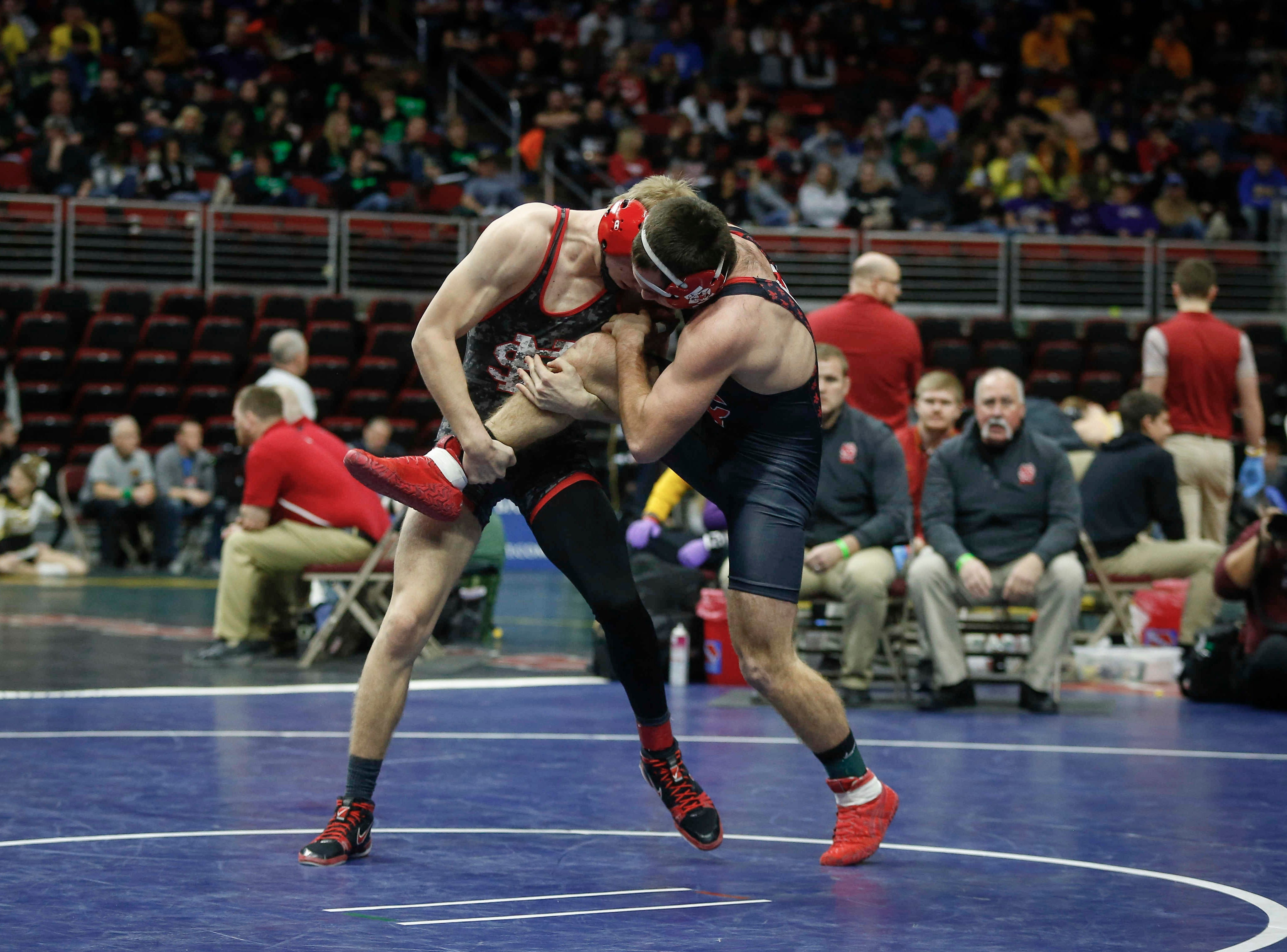 Iowa City High senior Kyle Hefley, right, is taken down by North Scott junior Jake Matthaidess in their match at 152 pounds during the state wrestling quarterfinals on Friday, Feb. 15, 2019, at Wells Fargo Arena in Des Moines.