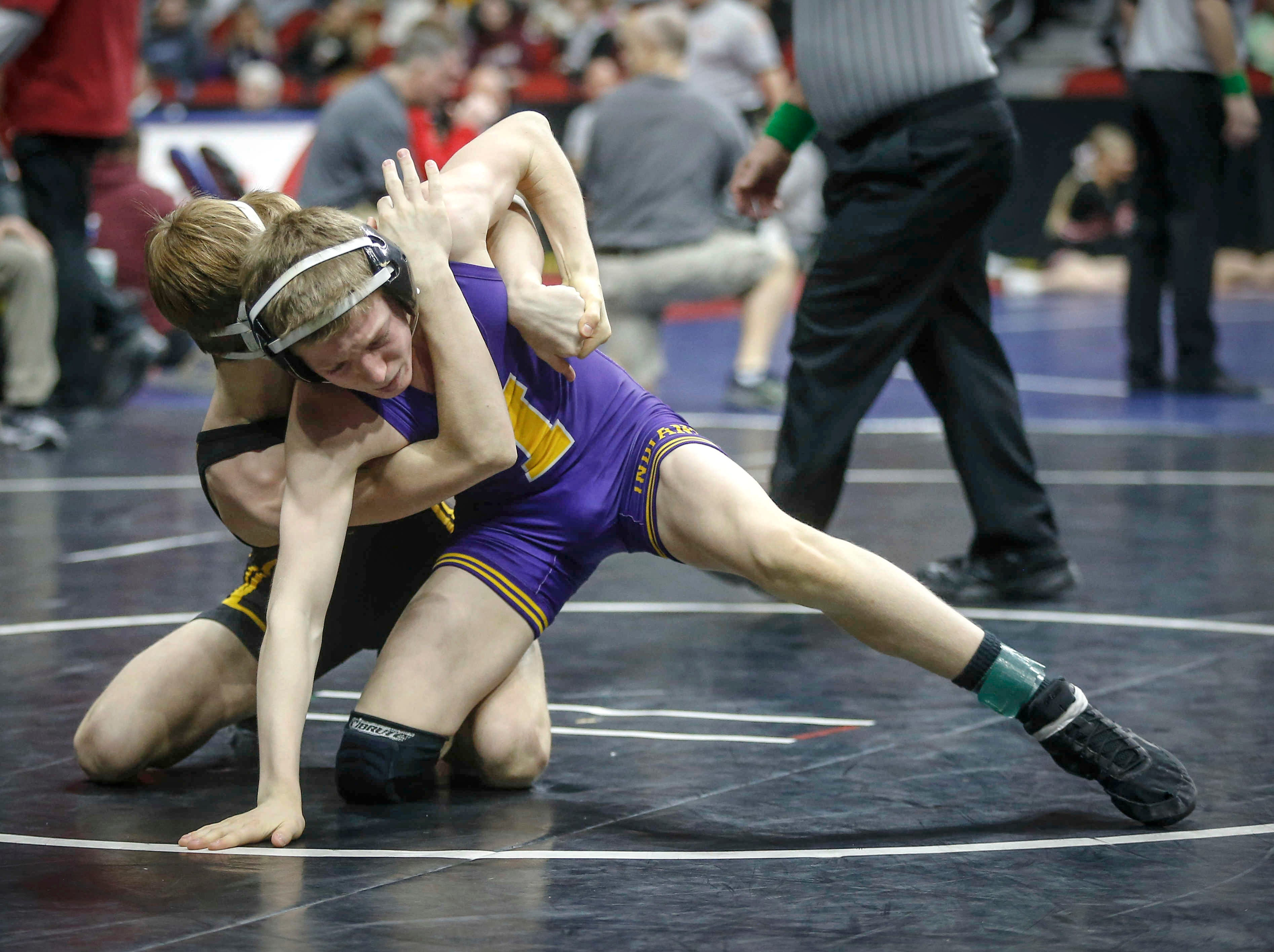 Ankeny's Trever Anderson breaks down Indianola's Ryder Downey in their match at 106 pounds during the state wrestling quarterfinals on Friday, Feb. 15, 2019, at Wells Fargo Arena in Des Moines.