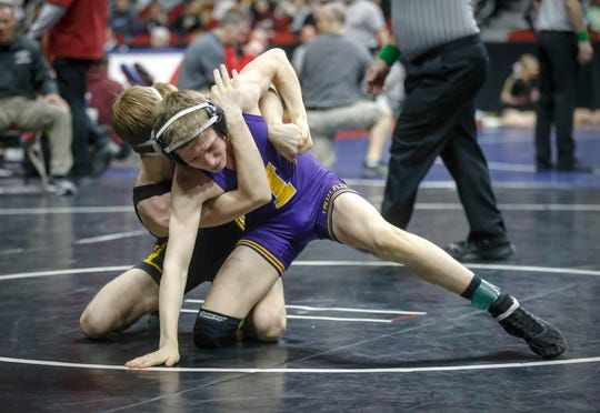 Indianola's Ryder Downey tried to break the grasp of Ankeny's Trever Anderson in their 106-pound match Friday during the state wrestling quarterfinals at Wells Fargo Arena in Des Moines.