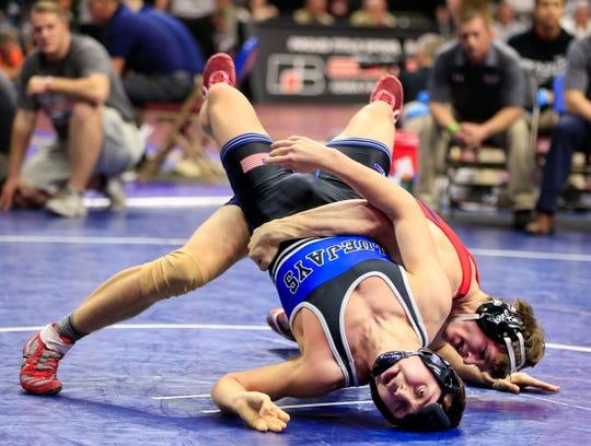 Skyler Noftsger of Ballard defeats Neal Larsen of Bondurant-Farrar during a 2A 160 Lb match at the state wrestling tournament Thursday, Feb. 14, 2019.