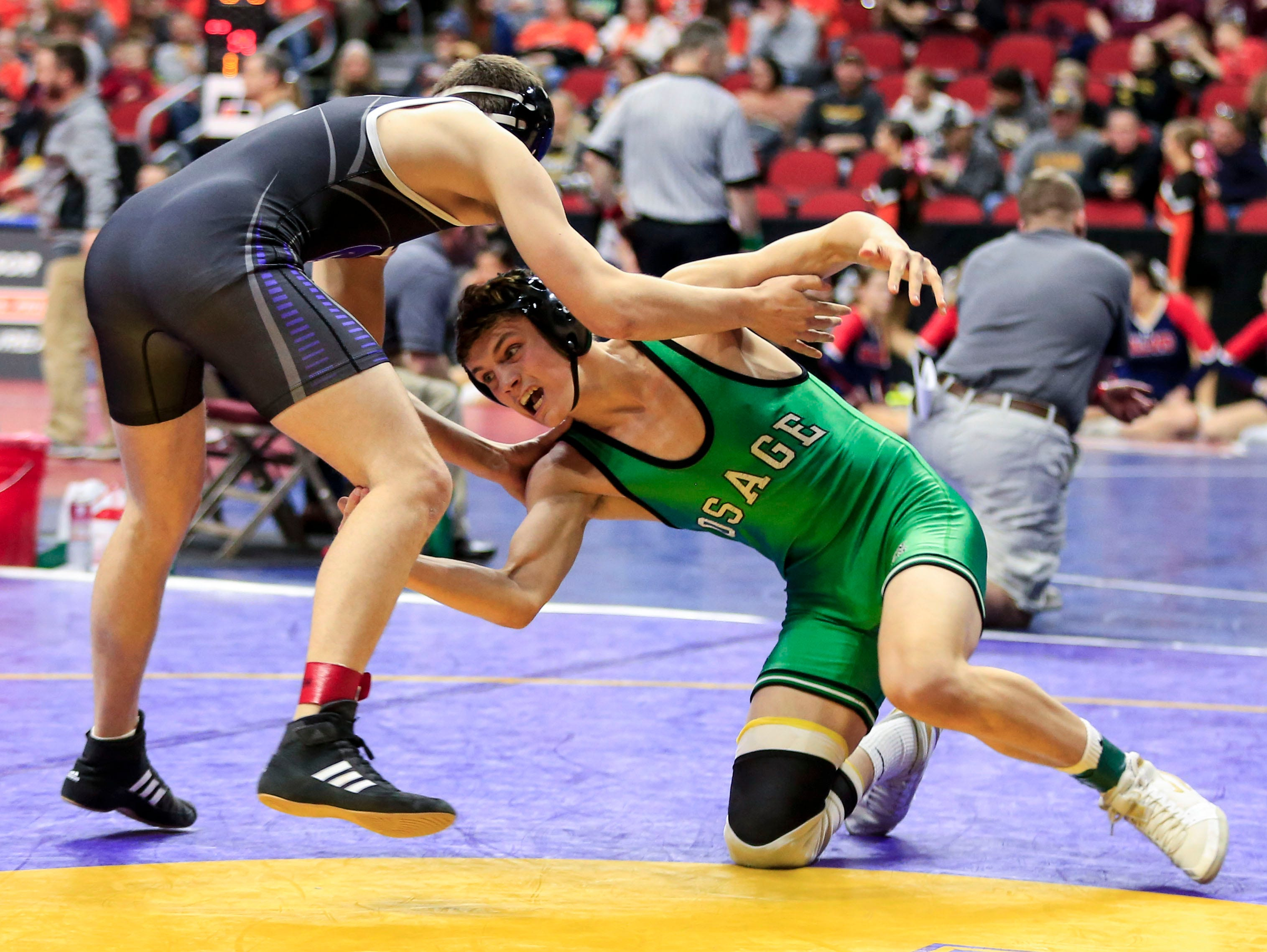 Spencer Mooberry of Osage defeats Bryan Graves of Oelwein during a 2A 170 Lb match at the state wrestling tournament Thursday, Feb. 14, 2019.